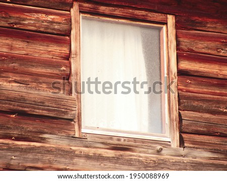 Wooden cabin with a window