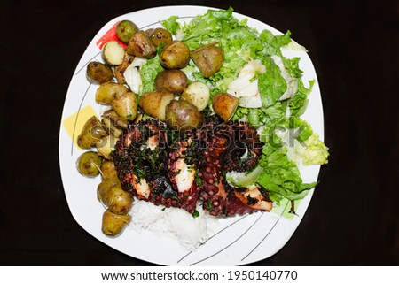 RICE WITH OCTOPUS, WITH SANCOCHADAS POTATOES, LETTUCE SALAD AND CHIMICHURRI SAUCE