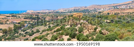 Aerial bird view of Kolymbethra Gardens and Valley of Temples, Agrigento, Sicily, Italy, with Temple of Concordia in the middle. Panoramic banner image, selective focus.
