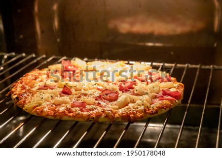Frozen pizza in electric owen Royalty-Free Stock Photo #1950178048