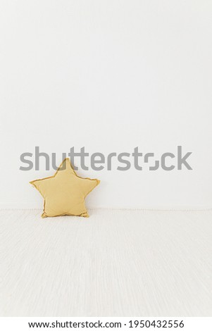 Kids concept stock photography with a yellow pillow for spring and summer 2021.