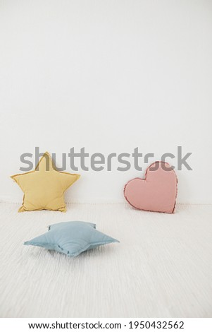 Playful stock photography, kids room concept for spring and summer with colorful pillows.