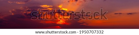 Panorama red and orange sunset background.Gorgeous Panorama twilight sky and cloud at morning background. Royalty-Free Stock Photo #1950707332