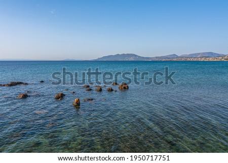 Beautiful seascape with rocks on the sea near the beach at Artemida, Athens, Greece. Greek seascape with rocky beach near Athens, Greece Royalty-Free Stock Photo #1950717751