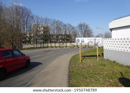 """Signpost sign """"Impfzentrum Covid-19"""" translates to """"Covid-19 vaccination center"""". Signposting of the parking lot. Location: Hürthpark, Germany."""