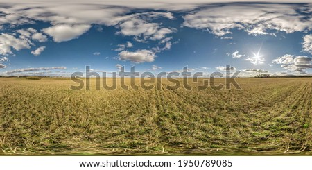 full seamless spherical hdri panorama 360 degrees angle view on among farming fields in summer day with awesome clouds in equirectangular projection, ready for VR AR virtual reality content Royalty-Free Stock Photo #1950789085