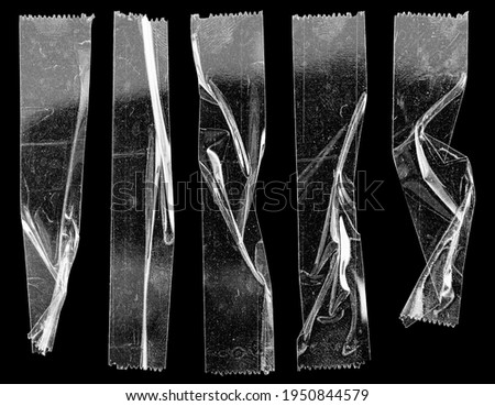 set of transparent adhesive tape or strips isolated on black background with nice light reflection, crumpled plastic sticky snips, poster design overlays or elements. Royalty-Free Stock Photo #1950844579
