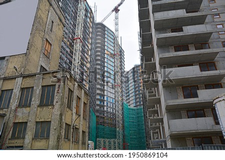 High-density and overcrowded housing and residential tower construction - ilustrating housing shortage, overpopulation and quick development Royalty-Free Stock Photo #1950869104