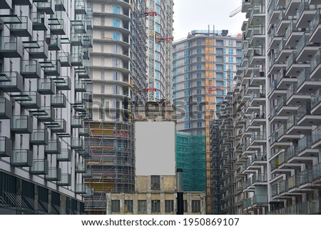 High-density and overcrowded housing and residential tower construction - ilustrating housing shortage, overpopulation and quick development Royalty-Free Stock Photo #1950869107