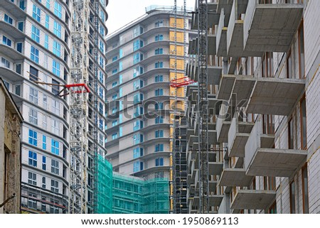 High-density and overcrowded housing and residential tower construction - ilustrating housing shortage, overpopulation and quick development Royalty-Free Stock Photo #1950869113