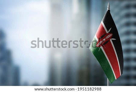 A small flag of Kenya on the background of a blurred background Royalty-Free Stock Photo #1951182988
