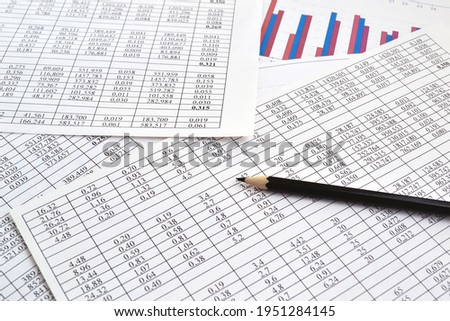 Photos of charts, diagrams and numbers showing the rise and fall in the market