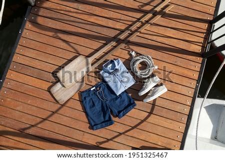 Children's fashion - a set of children's nautical clothing. Royalty-Free Stock Photo #1951325467