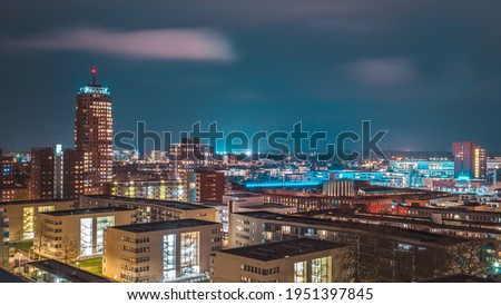 Panoramic picture at night of the skyline from Enschede, Holland, The Netherlands.