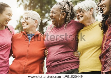 Happy multi generational women having fun together after sport workout outdoor - Focus on center woman face Royalty-Free Stock Photo #1951520449