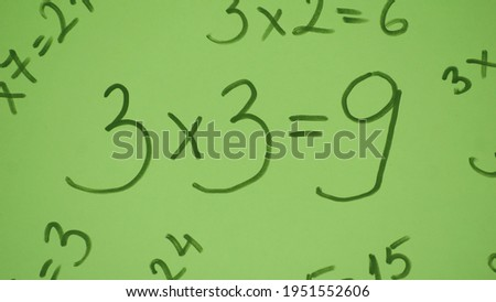 3x3 = 9, Multiplication of numbers isolated on green background.