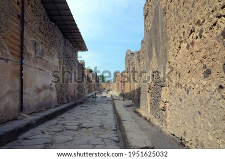 Ruins of Ancient Roman city of Pompeii Italy, was destroyed and buried with ash after Vesuvius eruption in 79 AD Royalty-Free Stock Photo #1951625032