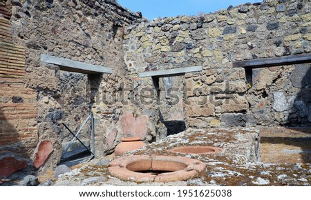 Ruins of Ancient Roman city of Pompeii Italy, was destroyed and buried with ash after Vesuvius eruption in 79 AD Royalty-Free Stock Photo #1951625038