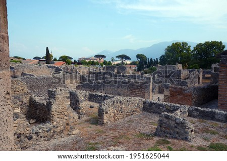 Ruins of Ancient Roman city of Pompeii Italy, was destroyed and buried with ash after Vesuvius eruption in 79 AD Royalty-Free Stock Photo #1951625044