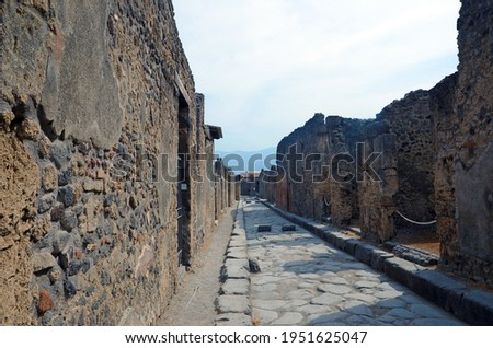 Ruins of Ancient Roman city of Pompeii Italy, was destroyed and buried with ash after Vesuvius eruption in 79 AD Royalty-Free Stock Photo #1951625047