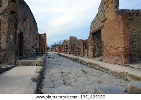 Ruins of Ancient Roman city of Pompeii Italy, was destroyed and buried with ash after Vesuvius eruption in 79 AD Royalty-Free Stock Photo #1951625050