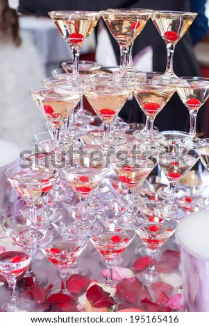 Champagne in glasses with fresh cherry on table - party background #195165416