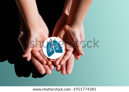 Adult and child hands holding lung, world tuberculosis day, world no tobacco day, lung cancer, coronavirus covid-19, Pulmonary hypertension, Pneumonia, copd, eco air pollution,organ donation concept Royalty-Free Stock Photo #1951774381