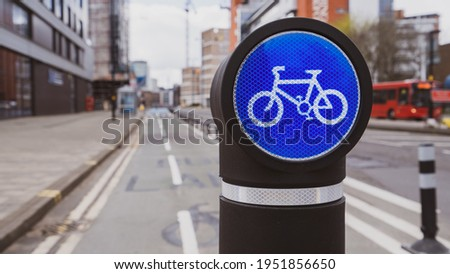 Cycle route sign on a bollard in a city centre