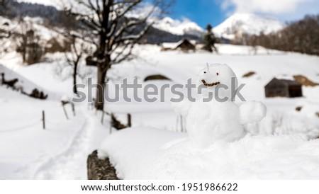 Snowman isolated in Unterwasser in Switzerland Royalty-Free Stock Photo #1951986622