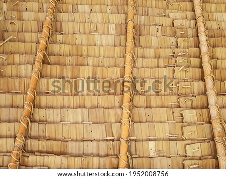 Close-up view from the southern side of a traditional thatched roof in a rural village. That thatched roof can be sunproof and rainproof. And good ventilation, popular to decorate restaurants, cafe. Royalty-Free Stock Photo #1952008756