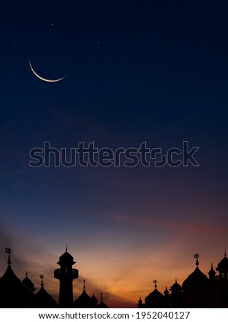 Mosques Dome on dark blue twilight sky and Crescent Moon on background Vertical, symbol islamic religion Ramadan and free space for text arabic, Eid al-Adha, Eid al-fitr Royalty-Free Stock Photo #1952040127