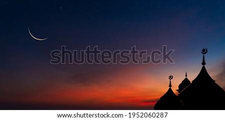 Mosques Dome on dark blue twilight sky and Crescent Moon on background, symbol islamic religion Ramadan and free space for text arabic, Eid al-Adha, Eid al-fitr, Mubarak, Islamic new year Muharram