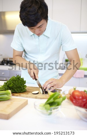 the image of a happy Asian father preparing food  #195213173