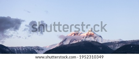 Panoramic View of the Famous Garibaldi Mountain during sunny winter sunset. Located in Squamish, North of Vancouver, British Columbia, Canada. Nature Background Panorama Royalty-Free Stock Photo #1952310349