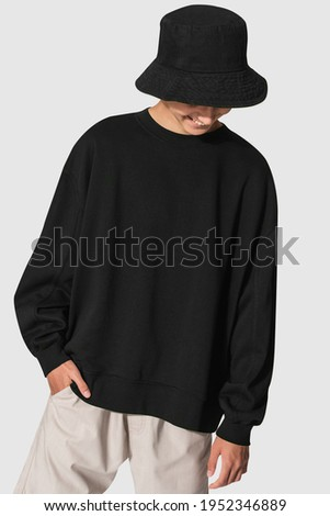 Man in black sweater and black bucket hat youth apparel shoot Royalty-Free Stock Photo #1952346889