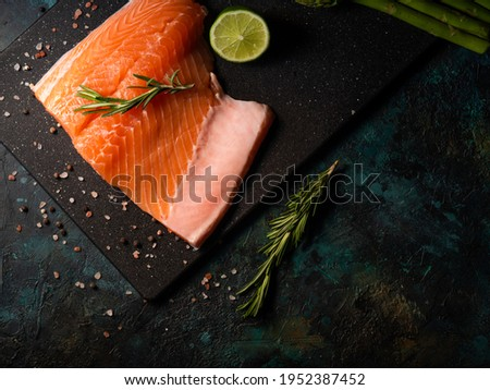 Fresh salmon fillet with rosemary and asparagus and lime. Top view. seafood. High resolution
