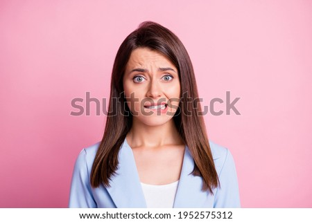 Portrait of stressed pretty brunette lady bite lips wear formal blazer isolated on pastel pink color background Royalty-Free Stock Photo #1952575312