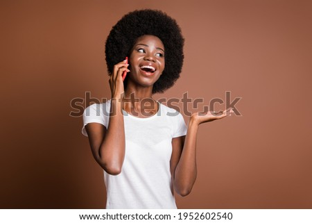 Photo of positive lady hold telephone talk look empty space wear white t-shirt isolated brown color background