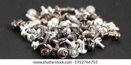 Screws and bolts fasteners industrial black background Royalty-Free Stock Photo #1952766763