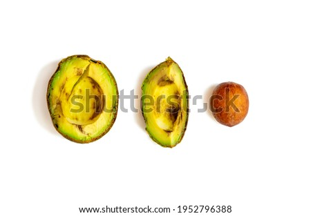 over-ripe, spoiled avocado on a white background Royalty-Free Stock Photo #1952796388