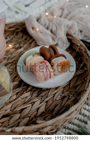 plate of macarons on a wicker tray resize