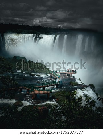 The people gather at the tip of the Iguazu waterfall, while getting completely wet