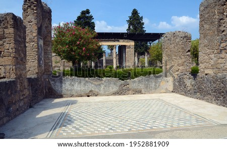 Ruins of Ancient Roman city of Pompeii Italy, was destroyed and buried with ash after Vesuvius eruption in 79 AD Royalty-Free Stock Photo #1952881909