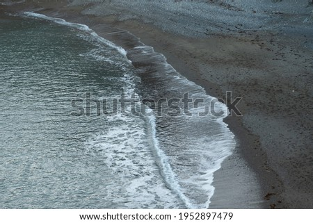 Waves movement on a shore. Flat sea, the calm of the flat sea, waves, beaches, water sports, meditation on the shore, ambient music, ebb and flow concept Royalty-Free Stock Photo #1952897479