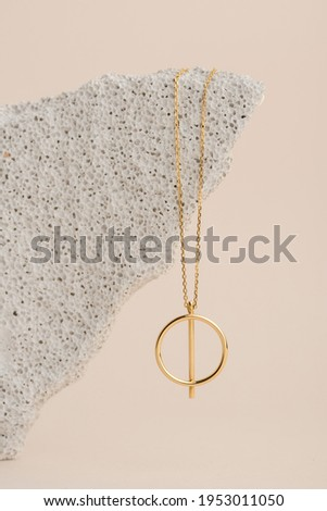 Elegant jewelry set of the gold pendant. Jewelry pendant. Product still life concept Royalty-Free Stock Photo #1953011050