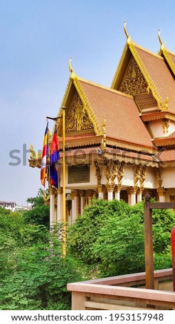 View of flags near Buddhist temple. Wat Langka. Phnom Penh. Cambodia. South-East Asia