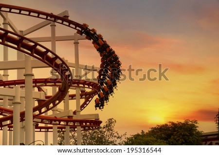 Roller Coaster loops in the sunset #195316544