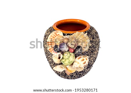 empty decorative ceramic plant pot isolated on white background. big modern porcelain vase for garden. Shiny bright colors glazed, vintage handmade pottery decorated with various mollusk seashells Royalty-Free Stock Photo #1953280171