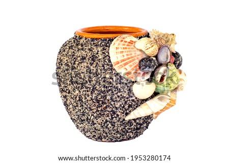 empty decorative ceramic plant pot isolated on white background. big modern porcelain vase for garden. Shiny bright colors glazed, vintage handmade pottery decorated with various mollusk seashells Royalty-Free Stock Photo #1953280174