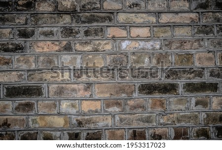 Weathered texture of stained old dark brown and red brick wall background, grungy rusty blocks of stone-work technology, colorful horizontal architecture Royalty-Free Stock Photo #1953317023